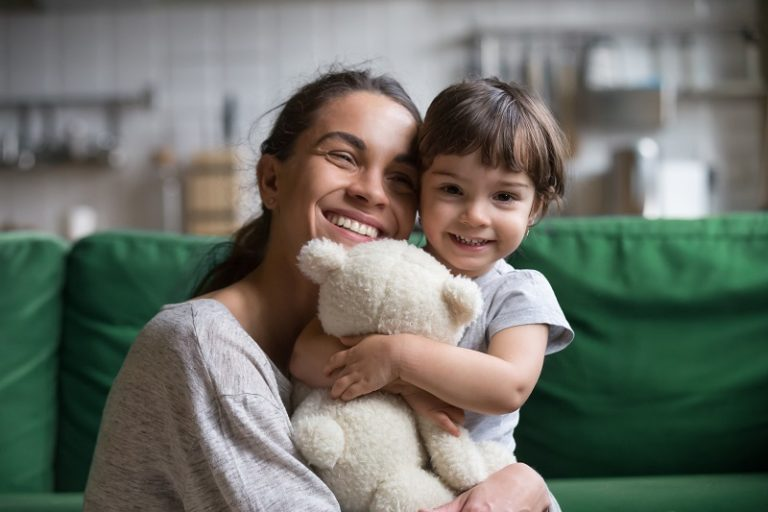 Happy Latino mom with her first foster child